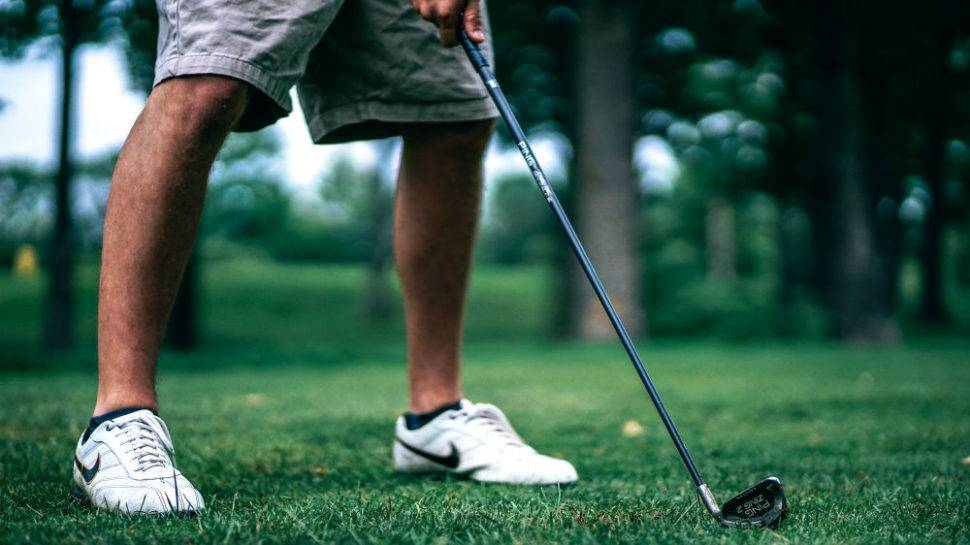 person golfing