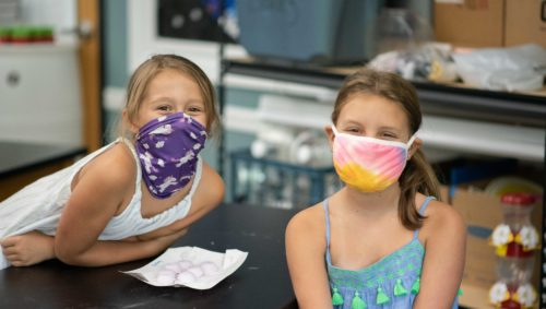 Two students wearing masks