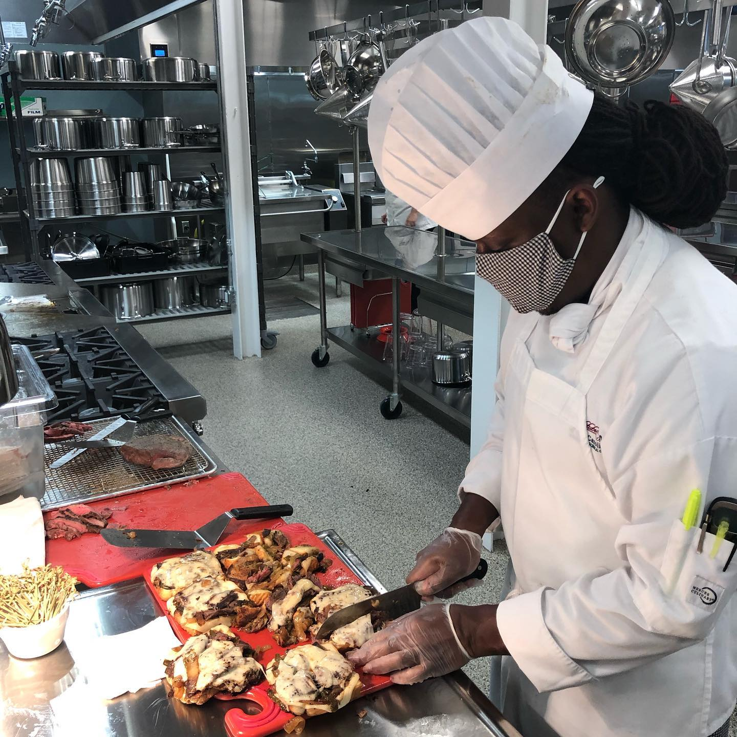 Student chef plating a dish