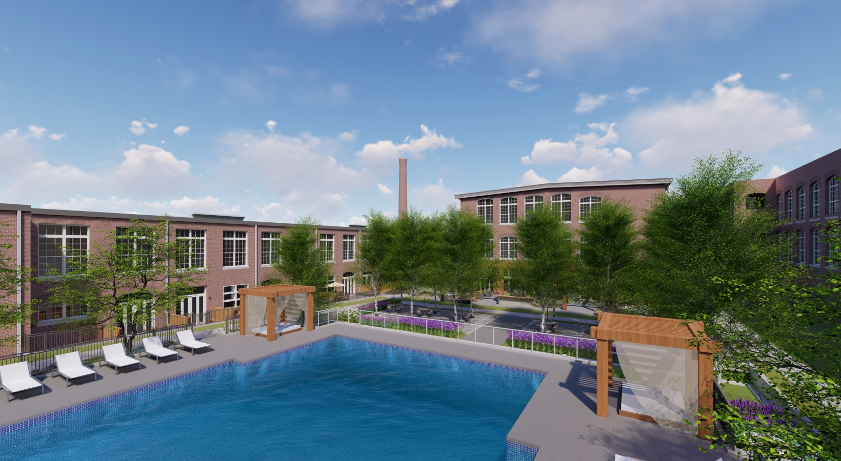 Brick mill in background with large pool and seating