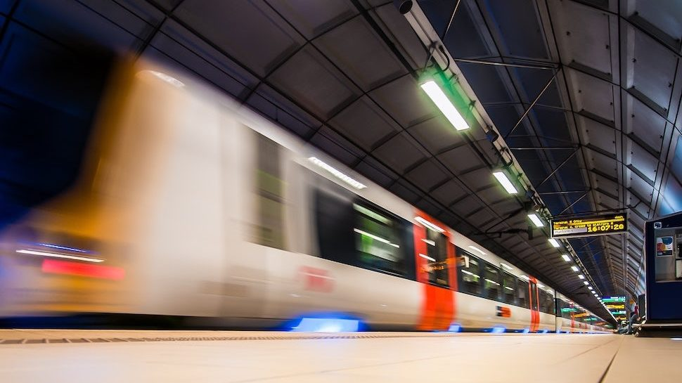 Blurred image of high speed train moving through tunnel