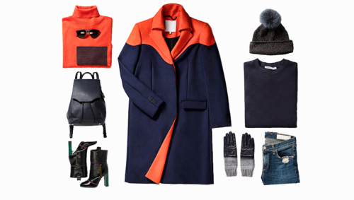 Flat lay photo of a navy blue and orange coat, leather boots, backpack, shoes, and hat